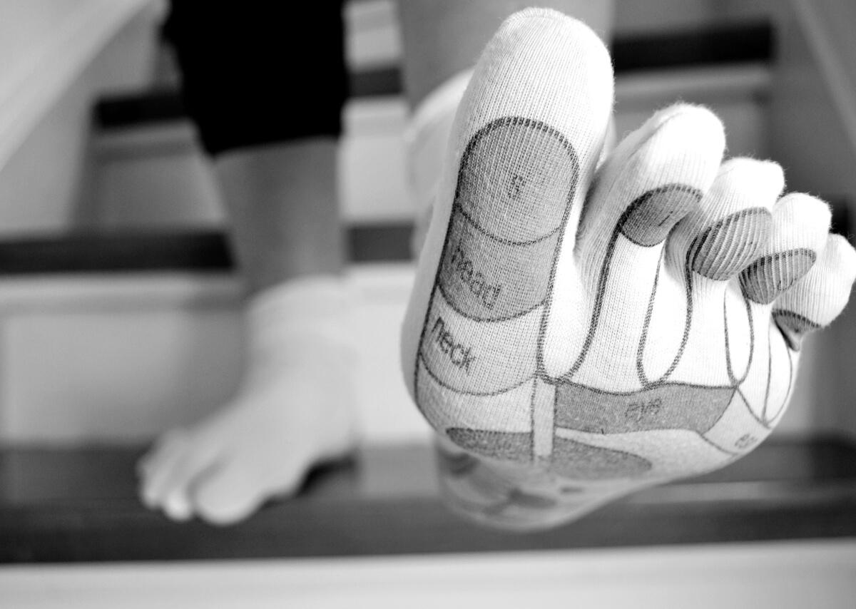 calzino con mappa riflessologia del piede